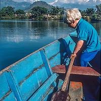 Ben Wiltsie helps to paddle a boat  on Phewa Tal Lake, near Pokhara, Nepal.