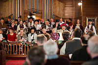 """Judy Buswell leads the chorus inviting guests to singalong to """"Count Your Blessings"""" during Singing the Old Time Religion at the Methodist Advent Christian Church in Lakeport on Sunday afternoon.  (Karen Bobotas/for the Laconia Daily Sun)"""