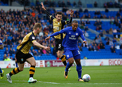 Cardiff City's Kenneth Zohore gets away from Sheffield Wednesday's David Jones (centre) during the Sky Bet Championship match at the Cardiff City Stadium.