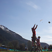 The Georgian team training at Recreation Park, in preparation for the IRB Rugby World Cup as paragliders descending from skyline lookout, prepare to land in a nearby field. Queenstown, New Zealand, 7th September 2011. Photo Tim Clayton....