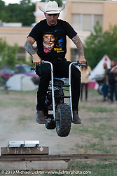 Alex Kronborg flies over a jump on his mini-bike in the makeshift downtown campground during the Run to Raton. Raton, NM. USA. Saturday July 21, 2018. Photography ©2018 Michael Lichter.