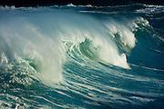 Giant winter surf on Oahu's North Shore at Waimea Bay, Hawaii