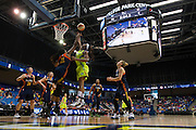 Glory Johnson of the Dallas Wings is fouled as she drives to the basket against the Connecticut Sun during a WNBA preseason game in Arlington, Texas on May 8, 2016.  (Cooper Neill for The New York Times)