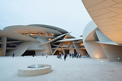 Dusk view of new National Museum of Qatar in Doha , Qatar. Architect Jean Nouvel.
