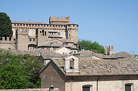 view of gradara Renaissance castle in Italy and roofs of village houses