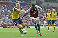 Aly Cissokho of Aston Villa (right) goes past Calum Chambers of Arsenal. Barclays Premier league match, Aston Villa v Arsenal at Villa Park in Birmingham on Saturday 20th Sept 2014<br /> pic by Mark Hawkins, Andrew Orchard sports photography.