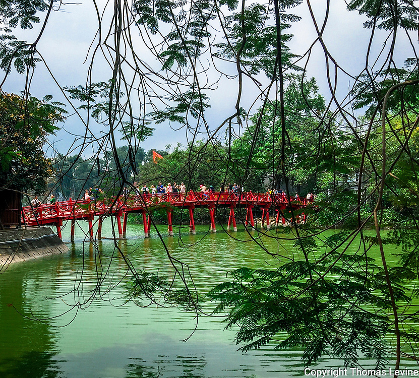 Hoan Kiem Lake red bridge to the temple photographed through the trees from the Old Quarter, Hanoi. iPhone