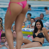 Viewers watch a participant walk on stage during the Miss Bikini Hungary beauty contest held in Budapest, Hungary on August 06, 2011. ATTILA VOLGYI