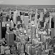 Above Midtown Manhattan, with both Madison Square Garden and the Empire State Building in view.