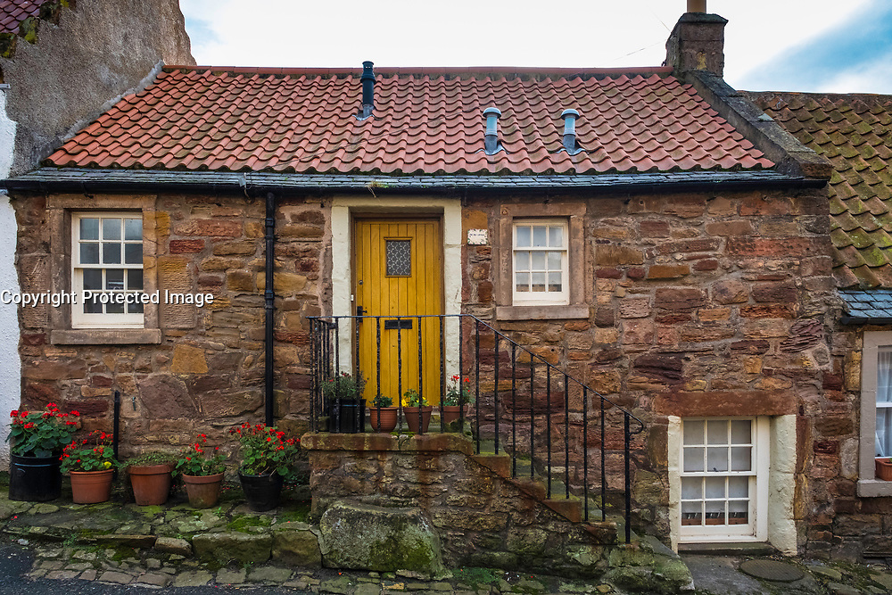 Exterior of picturesque old cottage in Crail on East Neuk of Fife in Scotland, United Kingdom