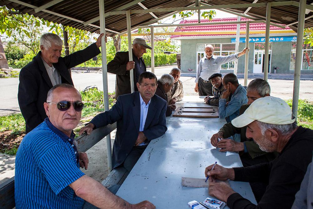 Men playing chess in the village of Ohanavan. Armenia, 2014.