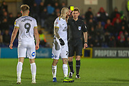 Peterborough United attacker Marcus Maddison (21) yellow card during the EFL Sky Bet League 1 match between AFC Wimbledon and Peterborough United at the Cherry Red Records Stadium, Kingston, England on 12 March 2019.