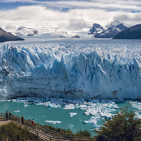 The Perito Moreno is one of the few growing glaciers in the world. This photo shows tourists, waiting to see huge pieces of ice plunging down into the water.