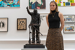 © Licensed to London News Pictures. 15/09/2021. London, UK. Bronze and slate statue of CAPTAIN SIR TOM MOORE by artist Richard Mossman is showing as part of the Royal Academy 253rd Summer Exhibition 2021. Photo credit: Ray Tang/LNP