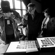 Bill Eppridge, center, team edits student work.