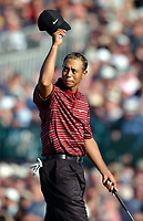 Tiger Woods (USA) doffs his cap to the galleries on the 18th and shows his bleached hair. The Open Golf Championship, Royal St.Georges, Sandwich, Day 4, 20/07/2003. Credit: Colorsport / Matthew Impey DIGITAL FILE ONLY