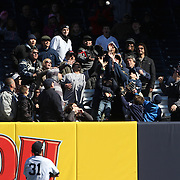 Ichiro Suzuki, New York Yankees, throws a ball into the crowd during the New York Yankees V Chicago Cubs, double header game one at Yankee Stadium, The Bronx, New York. 16th April 2014. Photo Tim Clayton