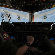 A C-17 Globemaster III aircrew,15th Airlift Squadron, approach a KC-135 Stratotanker with the 916th Air Refueling Wing from Seymour Johnson Air Force Base, N.C., to practice aerial refueling over South Carolina, July 14, 2014. Flight crews regularly perform training flights to stay current in their job qualifications. (U.S. Air Force photo by Staff Sgt. Perry Aston/released)