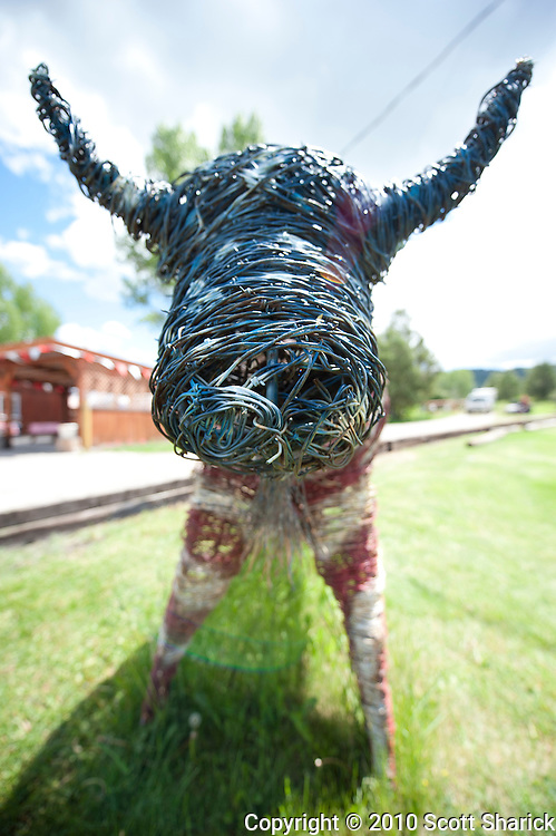 A barbed wire sculpture of a Bison in red, white, and blue. Missoula Photographer, Missoula Photographers, Montana Pictures, Montana Photos, Photos of Montana