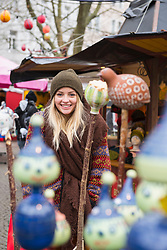 Portrait of young woman at Christmas market