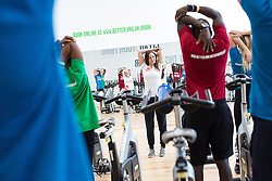 "© Licensed to London News Pictures . 01/03/2016 . Manchester , UK . Hollyoaks actress JENNIFER METCALFE (doing warm down stretches) launches a national fundraiser , "" The Better Bike Challenge "" from the East Manchester Leisure Centre in Beswick . The Challenge features 10,000 people cycling one-mile , each donating £1 to #TeamBetter for Sport Relief . Photo credit : Joel Goodman/LNP"