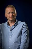 American-born British author, journalist and lecturer Patrick Ness , pictured at the Edinburgh International Book Festival where he talked about his series of books for young adults. The three-week event is the world's biggest literary festival and is held during the annual Edinburgh Festival. The 2013 event featured talks and presentations by more than 500 authors from around the world and was the 30th edition of the festival.