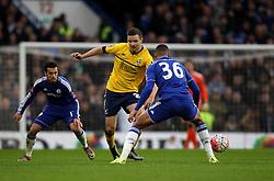 Charlie Goode of Scunthorpe United passes the ball past Ruben Loftus-Cheek of Chelsea - Mandatory byline: Robbie Stephenson/JMP - 10/01/2016 - FOOTBALL - Stamford Bridge - London, England - Chelsea v Scunthrope United - FA Cup Third Round