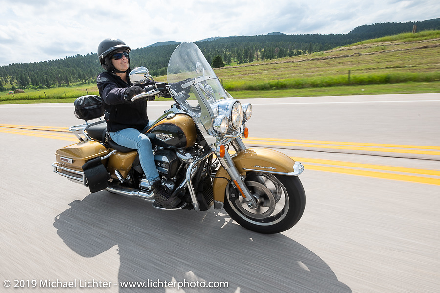 Moto-journalist Marjorie Kleiman, aks Shadow, on the Cycle Source ride down Vanocker Canyon back from Nemo to the Iron Horst Saloon during the Sturgis Black Hills Motorcycle Rally. SD, USA. Wednesday, August 7, 2019. Photography ©2019 Michael Lichter.