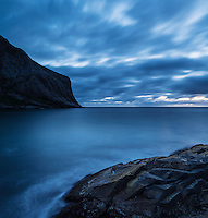 Evening light over dramatic coast at Horseid beach, Lofoten Islands, Norway