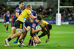 March 30, 2018 - Melbourne, VIC, U.S. - MELBOURNE, AUSTRALIA - MARCH 30 : Jack Maddocks of the Melbourne Rebels  is tackled by a Wellington Hurricanes player during Round 7 of the Super Rugby Series between the Melbourne Rebels and the Wellington Hurricanes on March 30, 2018, at AAMI Park in Melbourne, Australia. (Photo by Jason Heidrich/Icon Sportswire) (Credit Image: © Jason Heidrich/Icon SMI via ZUMA Press)