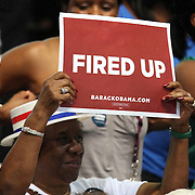 Fired Up supporters hold signs as President Barack Obama speaks during his Grassroots event at the Kissimmee Civic Center in Kissimmee, Florida on Saturday, September 8, 2012. (AP Photo/Alex Menendez)