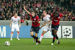 23.10.2012, Grand Stade Lille Metropole, Lille, OSC Lille vs FC Bayern Muenchen, im Bild Lucas DIGNE (OSC Lille - 03) und Aurelien CHEDJOU (OSC Lille - 22) stoppen Philipp LAHM (FC Bayern Muenchen - 21), // during UEFA Championsleague Match between Lille OSC and FC Bayern Munich at the Grand Stade Lille Metropole, Lille, France on 2012/10/23. EXPA Pictures © 2012, PhotoCredit: EXPA/ Eibner/ Ben Majerus..***** ATTENTION - OUT OF GER *****