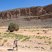 27 March 2007:  A participant runs across the gorge of El Maharch during third stage of the 22nd Marathon des Sables between jebel El Oftal and jebel Zireg (20.07 miles). The Marathon des Sables is a 6 days and 151 miles endurance race with food self sufficiency across the Sahara Desert in Morocco. Each participant must carry his, or her, own backpack containing food, sleeping gear and other material.
