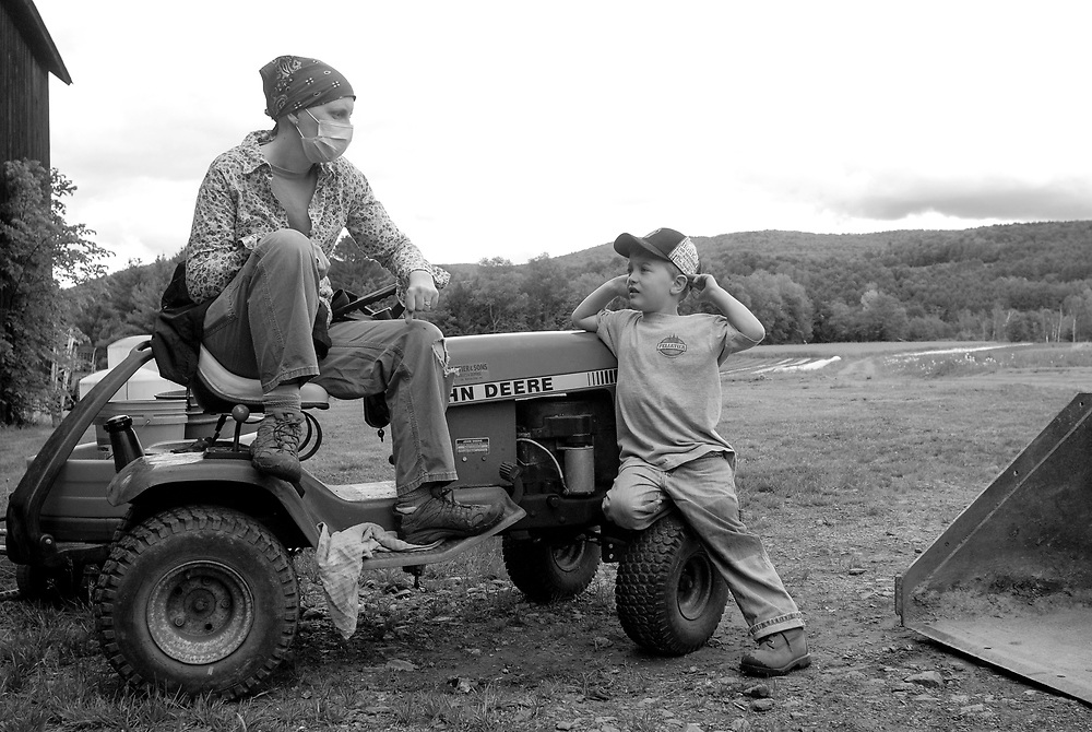 Amelia and Johnny on the tractor, Tuesday, May 22, 2012.