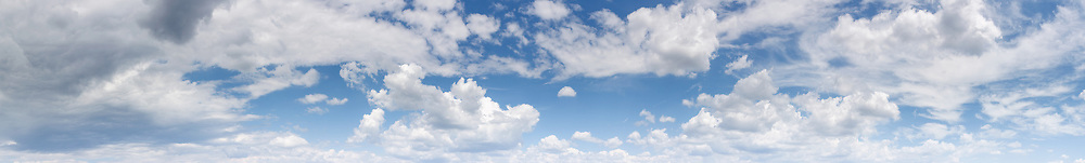 Panoramic image of blue sky with white clouds