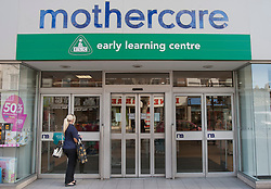 © licensed to London News Pictures. London, UK 12/04/2012. A woman waiting outside Mothercare before the shop opens this morning in Wood Green (12/04/12). Mothercare expected to be shutting 111 stores with 700 job losses. Photo credit: Tolga Akmen/LNP