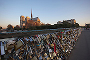 Padlocks clamped to the Pont de l'Archeveche bridge beside the Notre Dame de Paris. These 'Love Locks' are placed by couples across the world to symbolise their everlasting love. Seen here in Paris, France