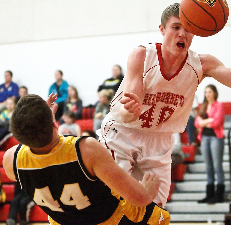 Heartland Lutheran's Isac Splattstoesser collides with McCool Junction's Terry Salyer and is called for an offensive foul in Tuesday's game at Heartland Lutheran High School. (Independent/Matt Dixon)