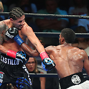 Marcus Browne throws a left hand to the body of Lenin Castillo during a Premier Boxing Champions fight on Saturday, August 4, 2018 at the Nassau Veterans Memorial Coliseum in Uniondale, New York.  (Alex Menendez via AP)