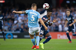February 23, 2019 - Melbourne, VIC, U.S. - MELBOURNE, VIC - FEBRUARY 23: Melbourne Victory midfielder Elvis Kamsoba (24) challenges the ball at round 20 of the Hyundai A-League Soccer between Melbourne City FC and Melbourne Victory on February 23, 2019 at Marvel Stadium, VIC. (Photo by Speed Media/Icon Sportswire) (Credit Image: © Speed Media/Icon SMI via ZUMA Press)
