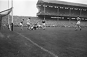 Group pf players in a tackle near the goal <br />