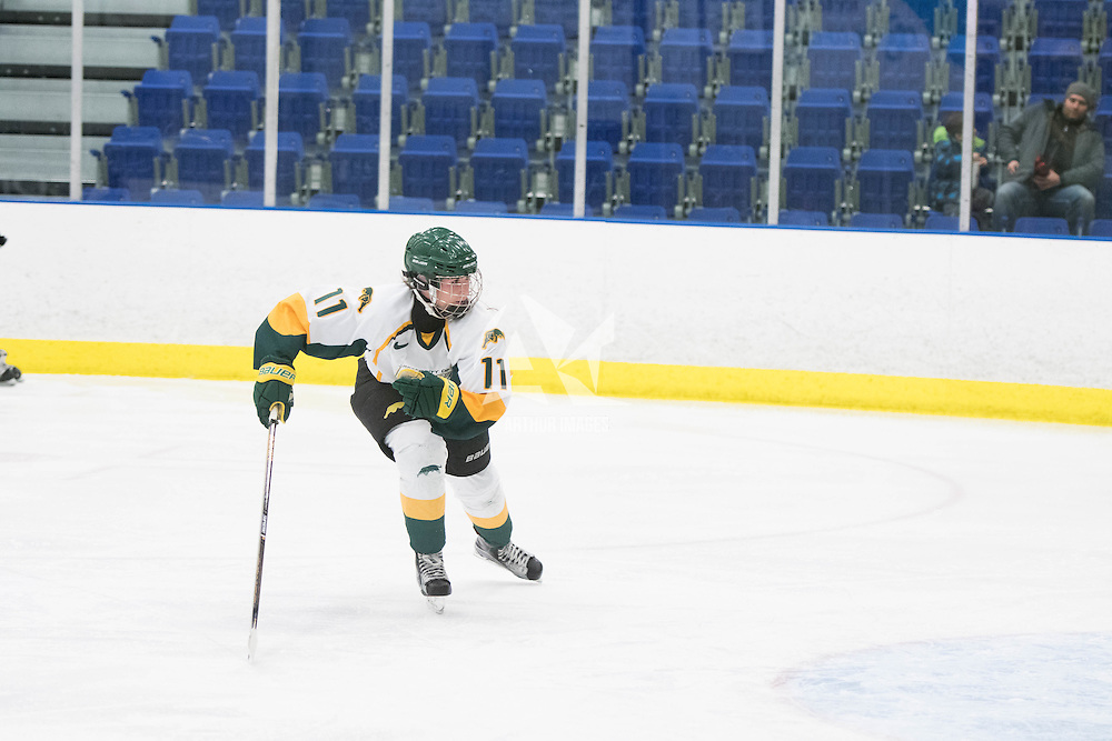 4th year defender Jolene Kirkpatrick (11) of the Regina Cougars in action during the Women's Hockey home game on January 7 at Co-operators arena. Credit: Arthur Ward/Arthur Images