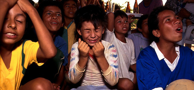 Children of the Choco-Uraba Region watching Colombia v Brazil football game, Colombia