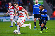 John Marquis of Doncaster Rovers (9) is chased by Gevaro Nepomuceno of Oldham Athletic (27) during the The FA Cup fourth round match between Doncaster Rovers and Oldham Athletic at the Keepmoat Stadium, Doncaster, England on 26 January 2019.