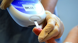 EMBARGOED TO 0001 MONDAY APRIL 15 File photo dated 17/12/18 of a nurse giving a patient a diabetes test. Women with Type 2 diabetes are less likely than men to be prescribed statins to prevent heart attacks and strokes, new research suggests.