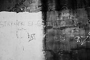 Un muro nel complesso delle case popolari di Tor Sapienza con la scritta - Stranieri si, schiavi no -,  Roma 14 Novembre 2014.  Christian Mantuano / OneShot