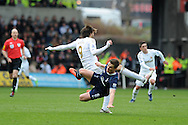 Swansea city's Michu collides with Tottenham's Scott Parker and is booked for this challenge. Barclays Premier League, Swansea city v Tottenham Hotspur at the Liberty Stadium in Swansea, South Wales on Saturday 30th March 2013. pic by Andrew Orchard, Andrew Orchard sports photography,