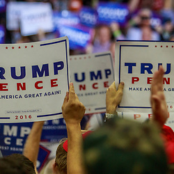 Mechanicsburg, PA – August 1, 2016: Supporters of Presidential candidate Donald J. Trump wave signs during a political rally.