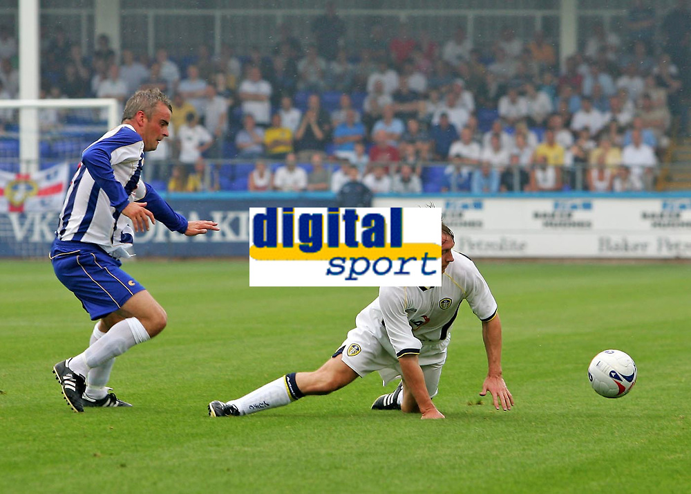 Photo: Andrew Unwin.<br />Hartlepool United v Leeds United. Pre Season Friendly. 22/07/2006.<br />Former Millwall captain, David Livermore (R), is now a Leeds player, and here loses out to Hartlepool's Mark Tinkler (L).