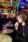 """Ken Mochiduki (32), one of the managers of club """"Ai"""", explains how the payment system works and how a host's salary can even reach 10 million yen a month, if a host can survive the hardship of night-life and drinking. Club """"Ai"""" (love in Japanese) is one of the oldest host clubs in Kabukicho entertainment area near Shinjuku. It started functioning 37 years ago, with hosts ready to take care of the needs of their female customers. The customers have to pay from 5000 friendly price for beginners, to millions of yen, depending on how good the host is in pleasing the customer and encouraging her to buy drinks. On top of these a good host can receive expensive gifts from his regular customers.  Tokyo - JAPAN"""